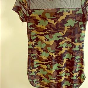 A camp top with sheer chest area.